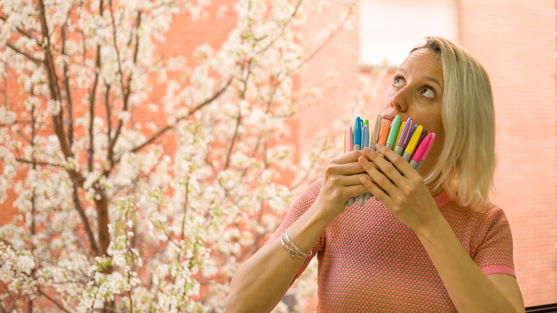 Clara holding colourful markers beautifully arranged