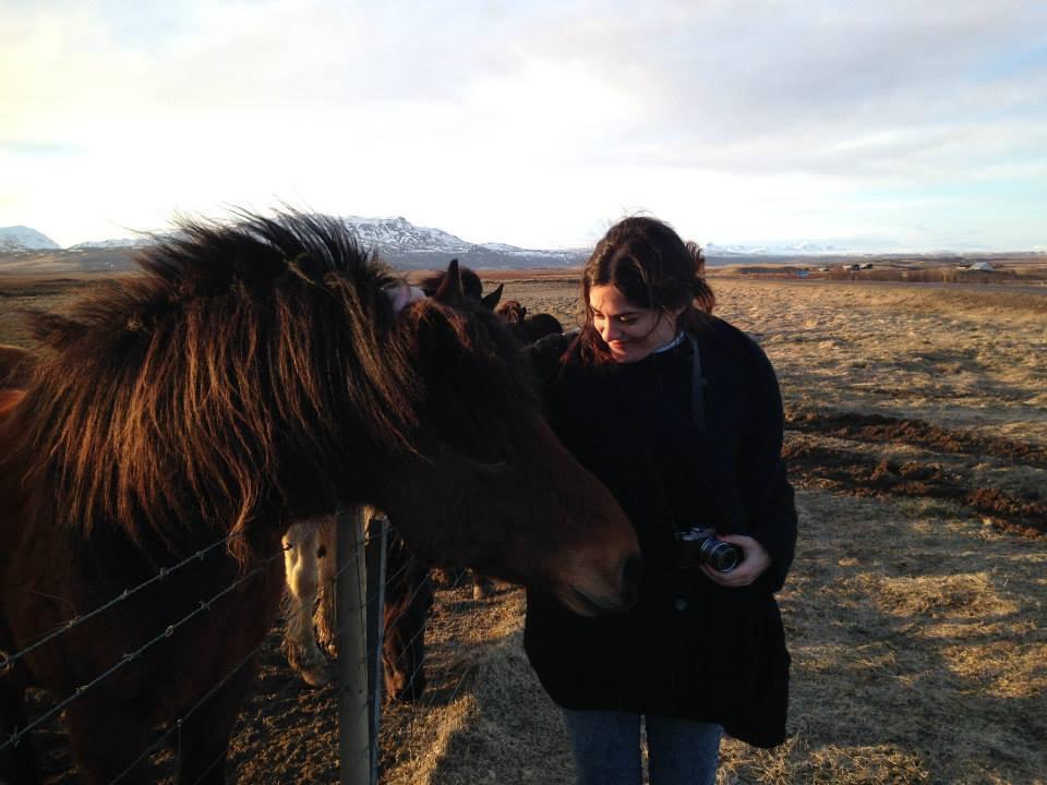 Ester petting a horse